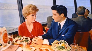 Elvis Presley eating a Big Salad during the making of It Happened at the World's Fair at the Space Needle Restaurant