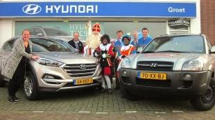 Margriet Groet en het team van monteurs van Autobedrijf Arjan Groet, samen met enkele vrijwilligers van het Sint Nicolaas Genootschap