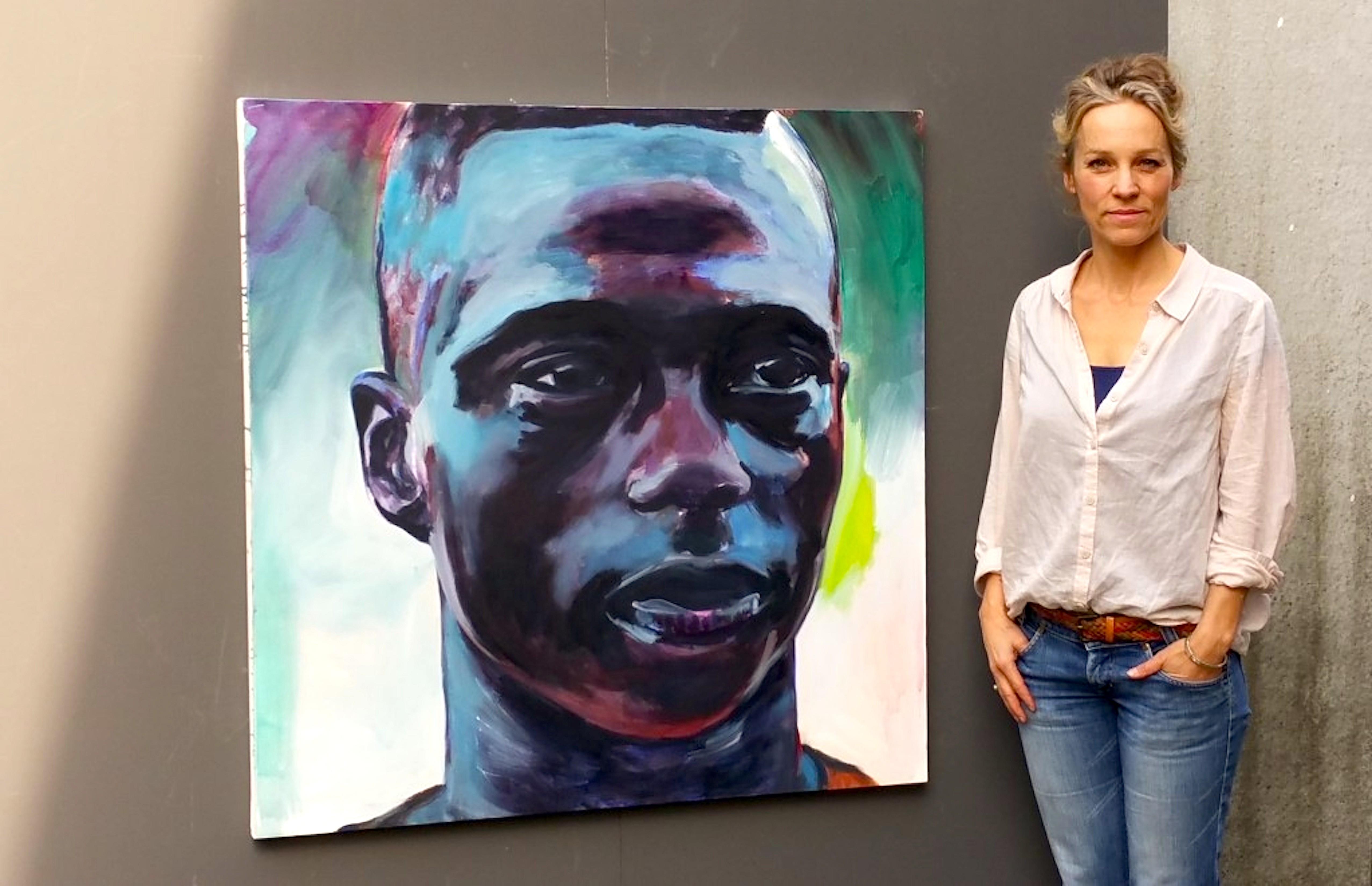 Chantal Spit met portret van Quincy Promes (foto Jubileumboek FC Twente)
