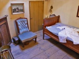 De slaapkamer van de werkster in Salon Nune Ville