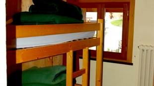 De slaapkamer met stapelbed in Chalet La Grenouillere (foto Sportiek Reizen)