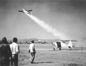The first rocket powered airplane launch in the U.S. Pasedena California, 1941, Parsons and colleagues watch from the foreground
